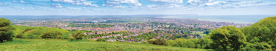 Eastbourne seaside resort panorama viewed from South Downs Way National Trail Sussex South East England UK