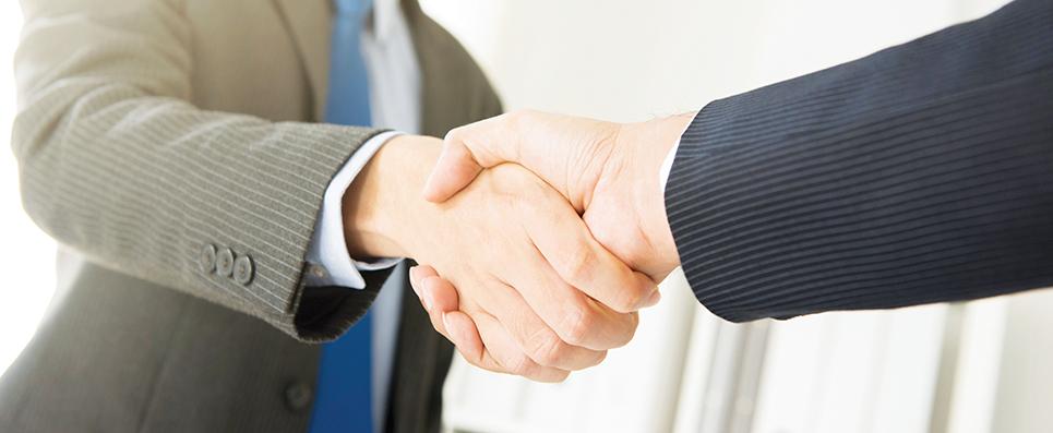 Businessmen making handshake  panoramic banner