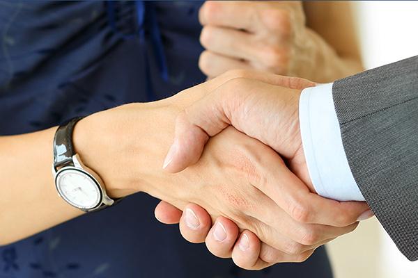 DMH Stallard Handshake WEB