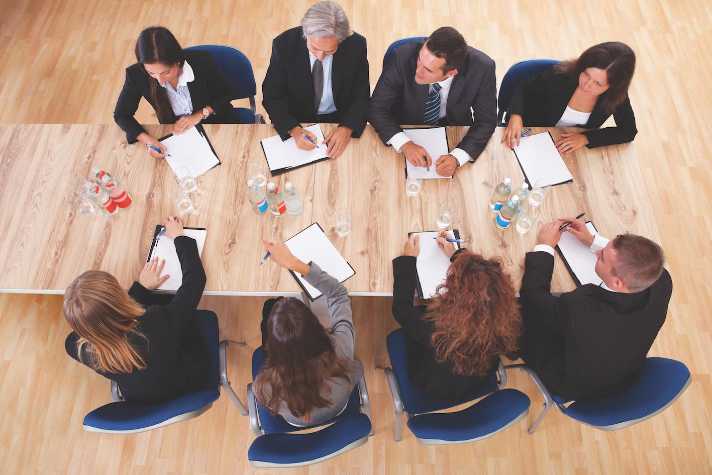 Herr Business people in a meeting