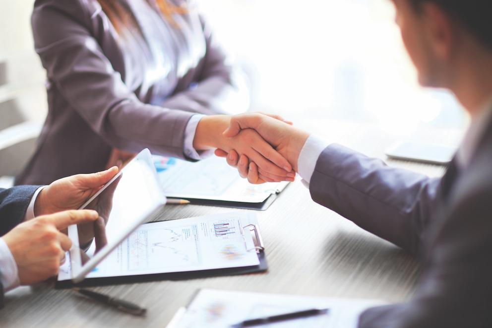 Fletcher Business people shaking hands